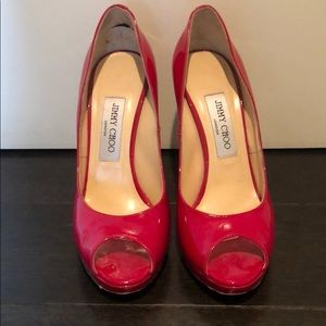 Jimmy Choo red patent leather pumps.